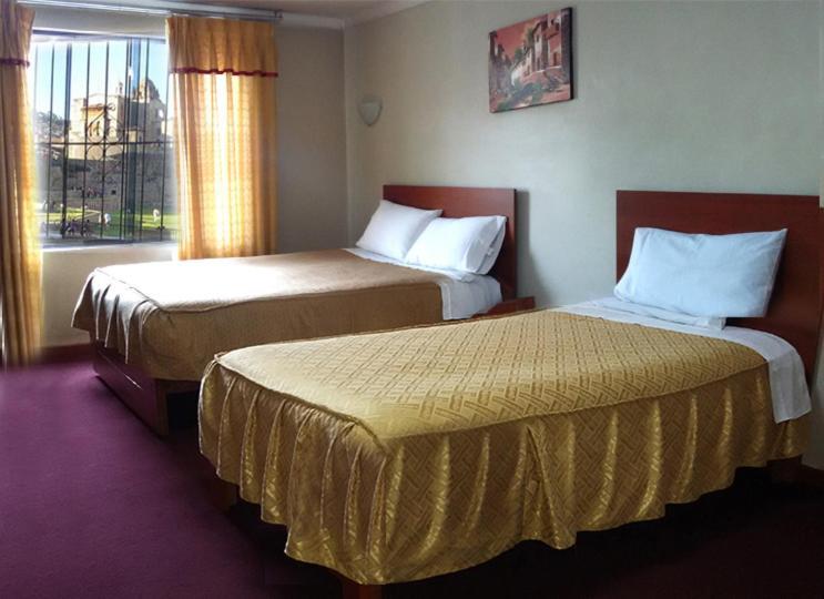 Cama o camas de una habitación en Hostal Lucerito