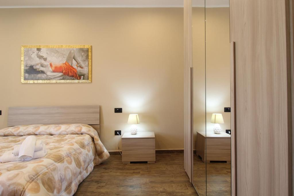 A bed or beds in a room at B&B Corso Roma