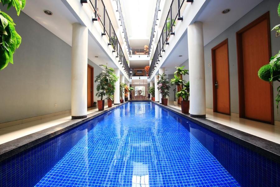 The swimming pool at or near Cilandak Mansion