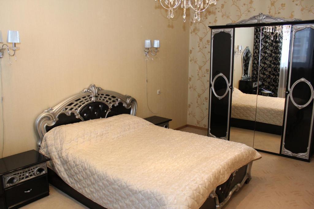 Кровать или кровати в номере Гостиница Воронеж