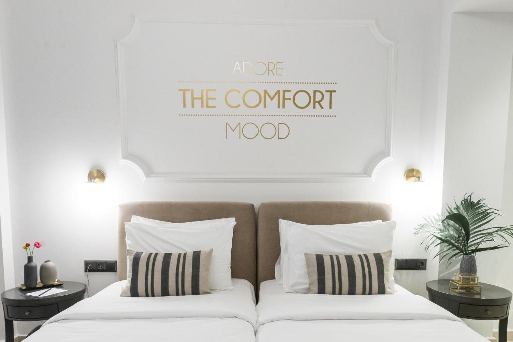 מיטה או מיטות בחדר ב-The Mood Luxury Rooms