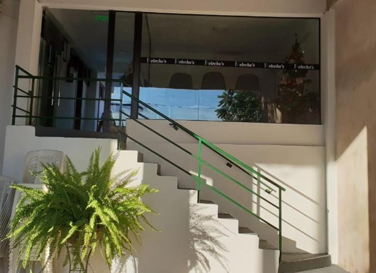 A balcony or terrace at Helecho's Hostal