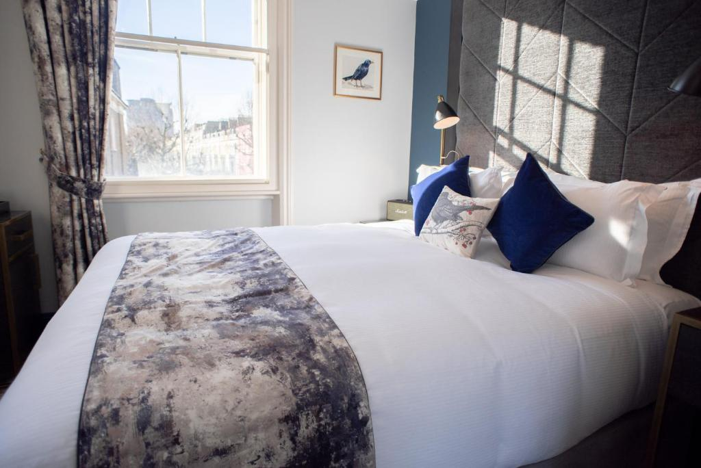 Llit o llits en una habitació de Blackbird