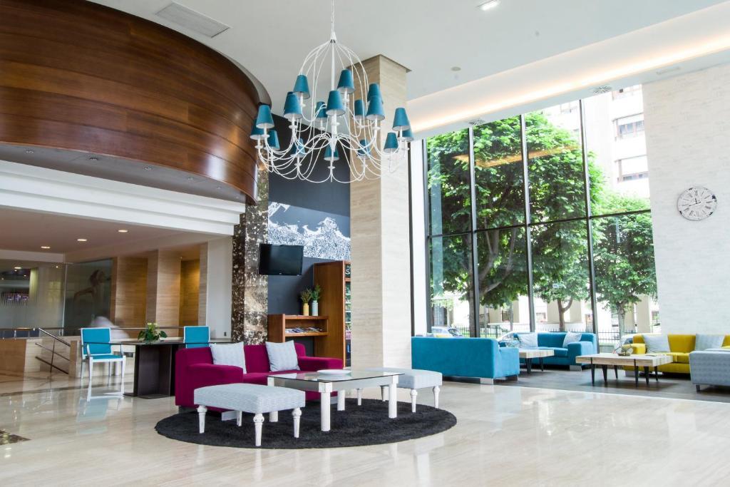 The lobby or reception area at Tryp Gijón Rey Pelayo Hotel