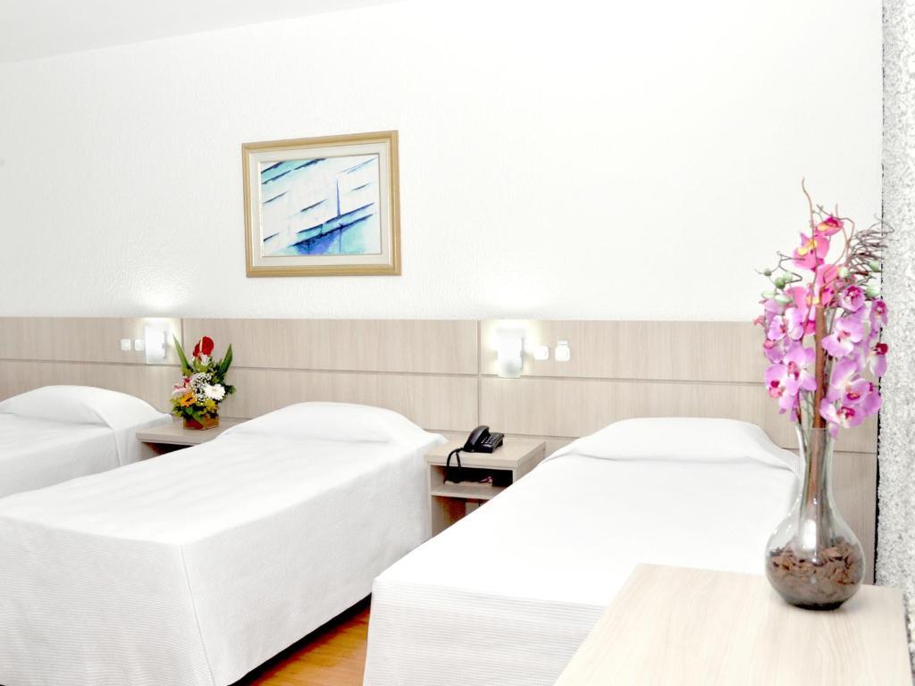 Cama ou camas em um quarto em Caravelle Palace Hotel