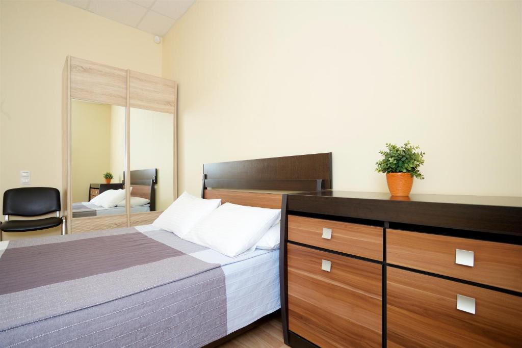 Кровать или кровати в номере Мини-отель на Большом Проспекте В.О,
