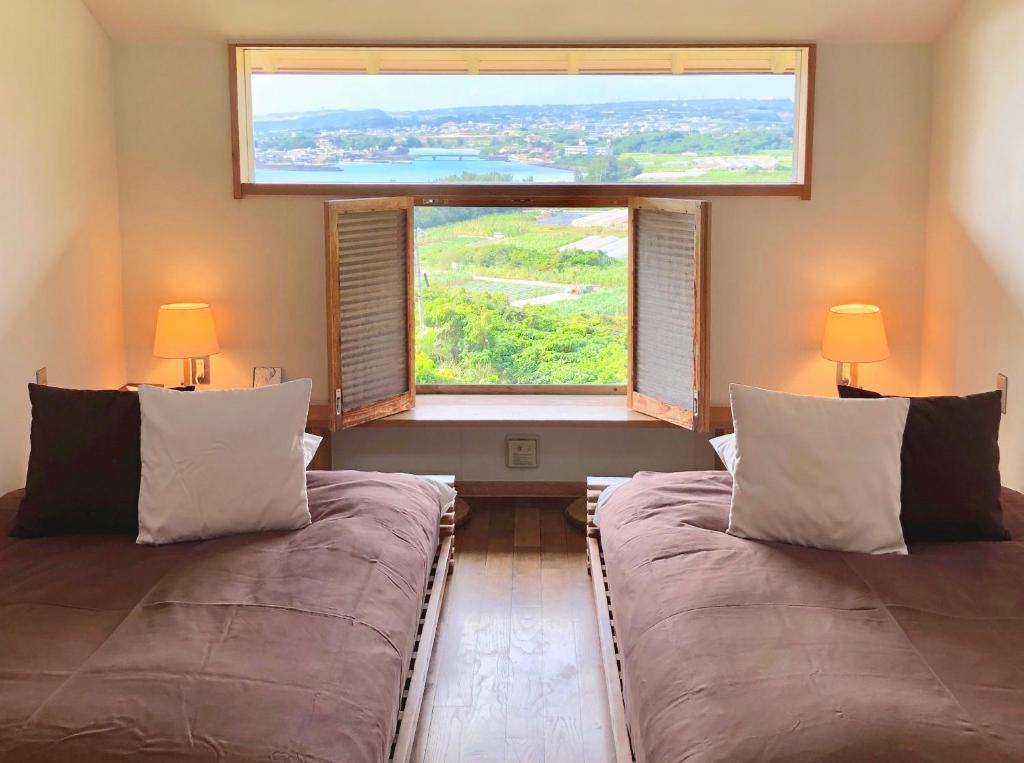 A bed or beds in a room at Kaiza