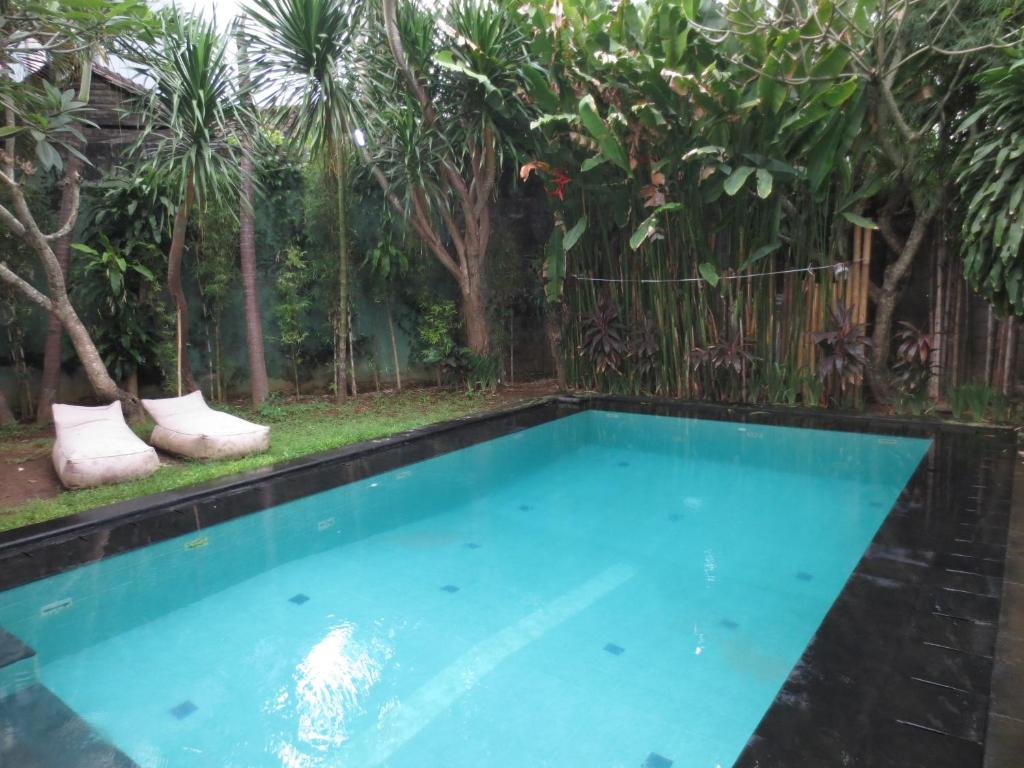 The swimming pool at or near Touring Sanur