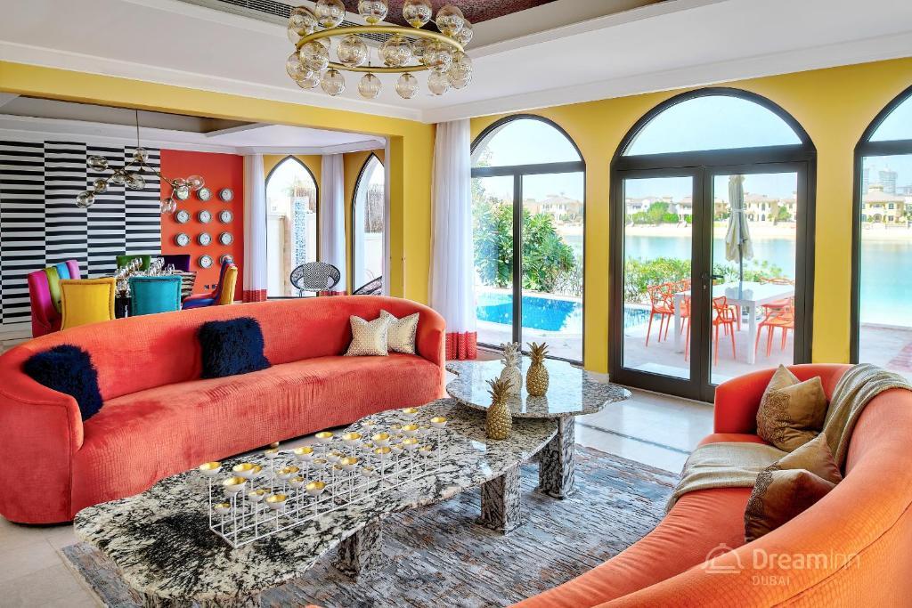 Predel za sedenje v nastanitvi Dream Inn - Palm Island Retreat Villa