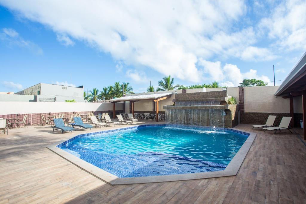 The swimming pool at or near Barravento Praia Hotel