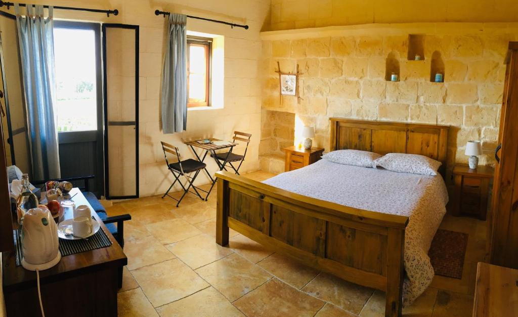 A bed or beds in a room at The Travellers Inn - Gozo