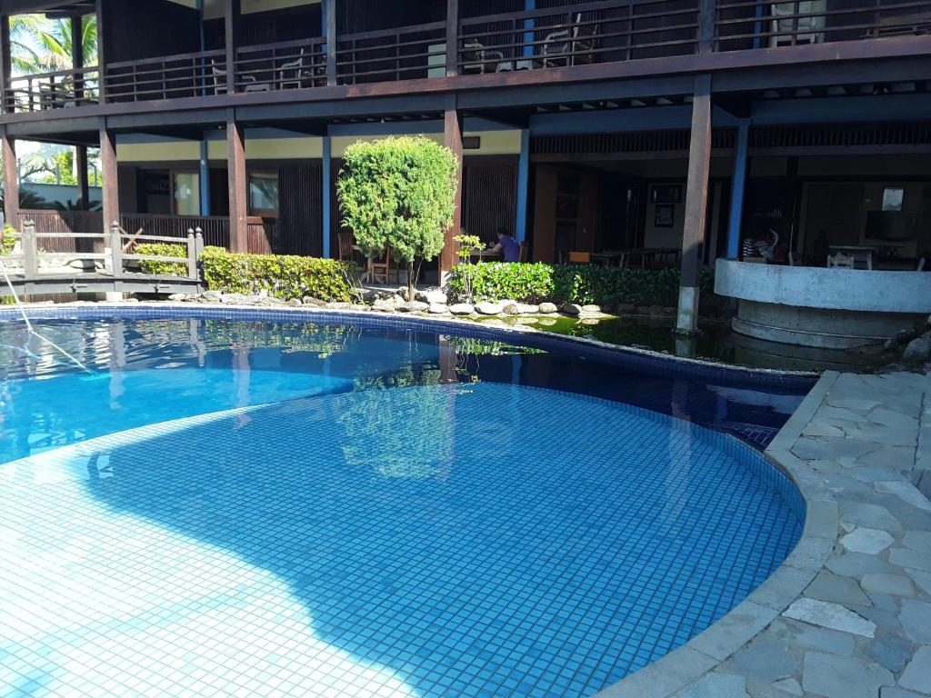 The swimming pool at or near Charme Hotel Guarujá