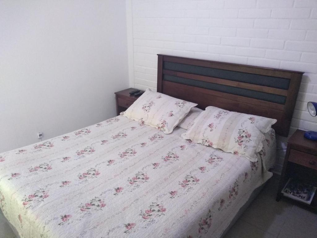 Cama o camas de una habitación en Hotel Angamos
