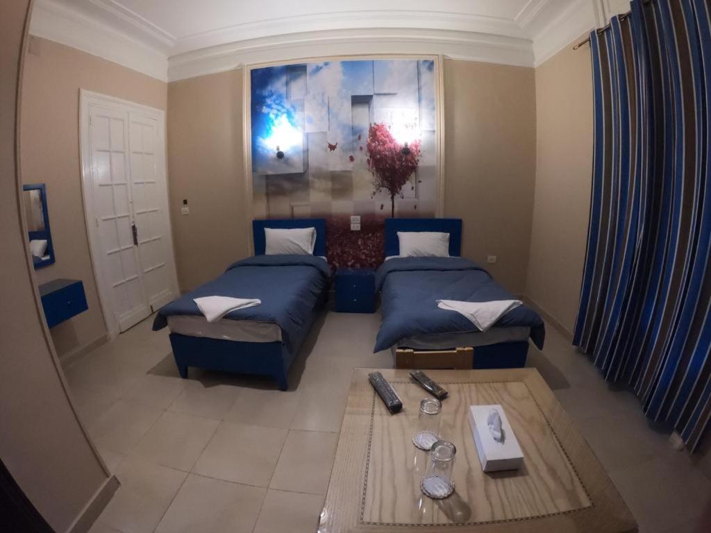 Voodi või voodid majutusasutuse Midas Hotel toas