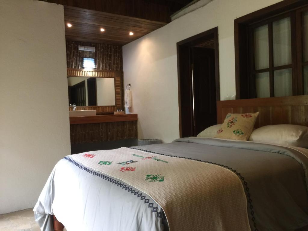 Cama o camas de una habitación en Ecolodge Naha - Selva Lacandona