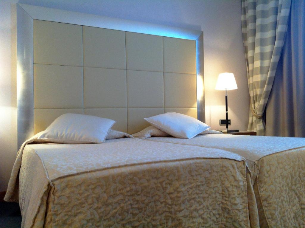 A bed or beds in a room at Papillo Hotels & Resorts Roma