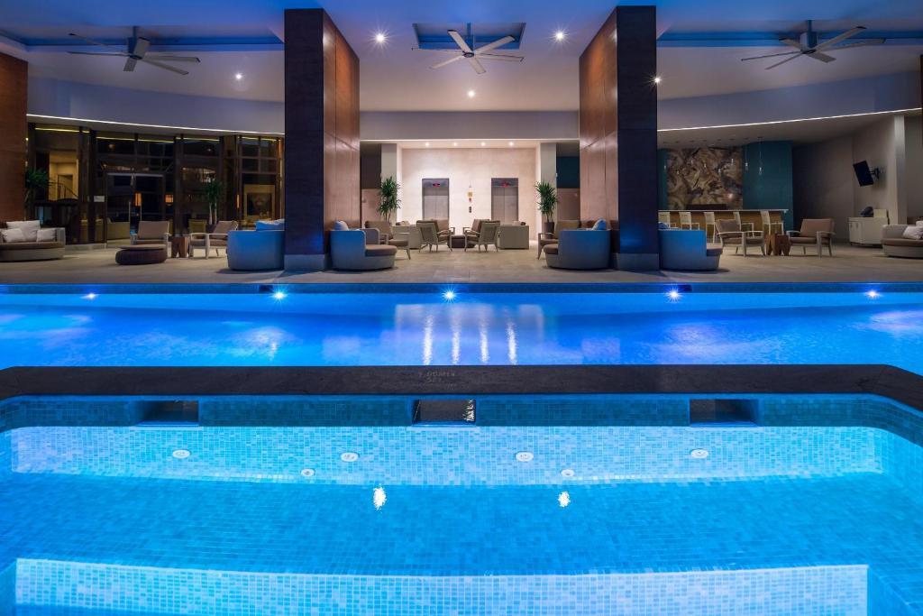 The swimming pool at or near Waldorf Astoria Panama