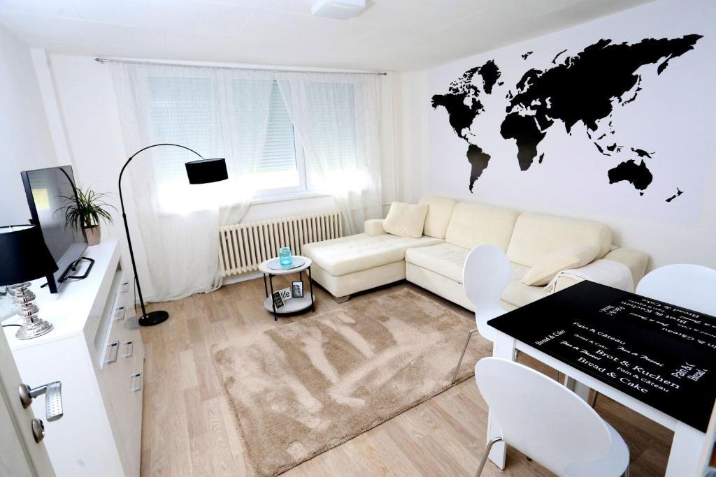 Een zitgedeelte bij Apartman City Lux