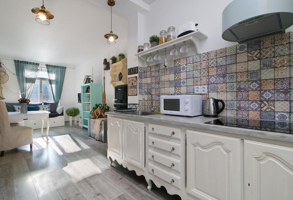 Η κουζίνα ή μικρή κουζίνα στο Fish & Fish