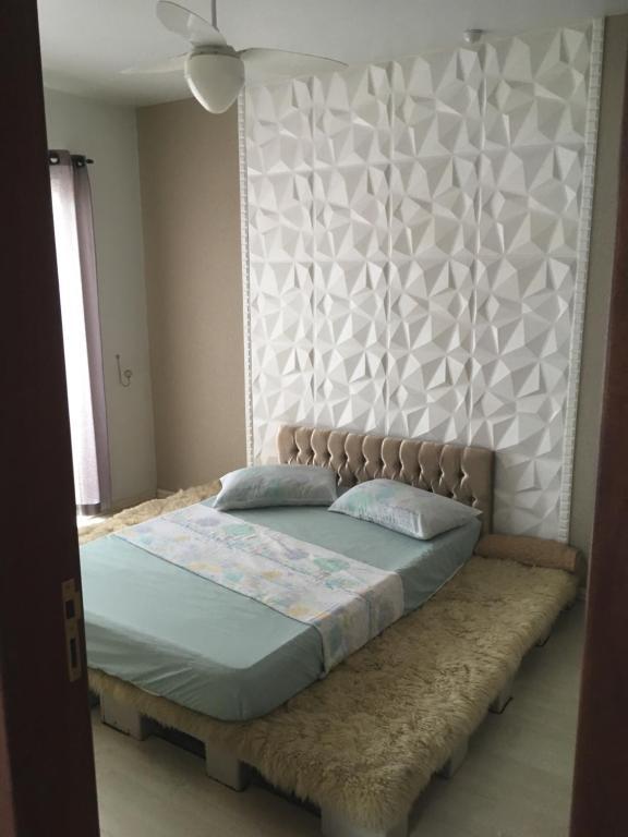 A bed or beds in a room at Apto Aconchegante no Litoral de SC