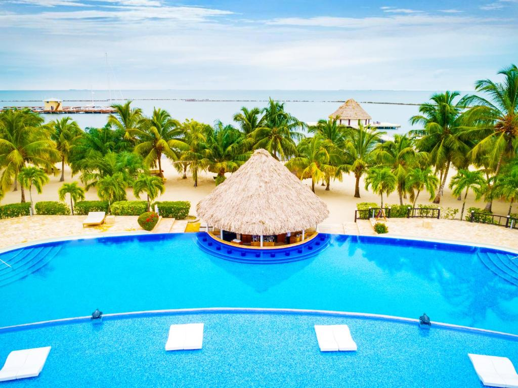 A view of the pool at The Placencia, a Muy'Ono Resort or nearby