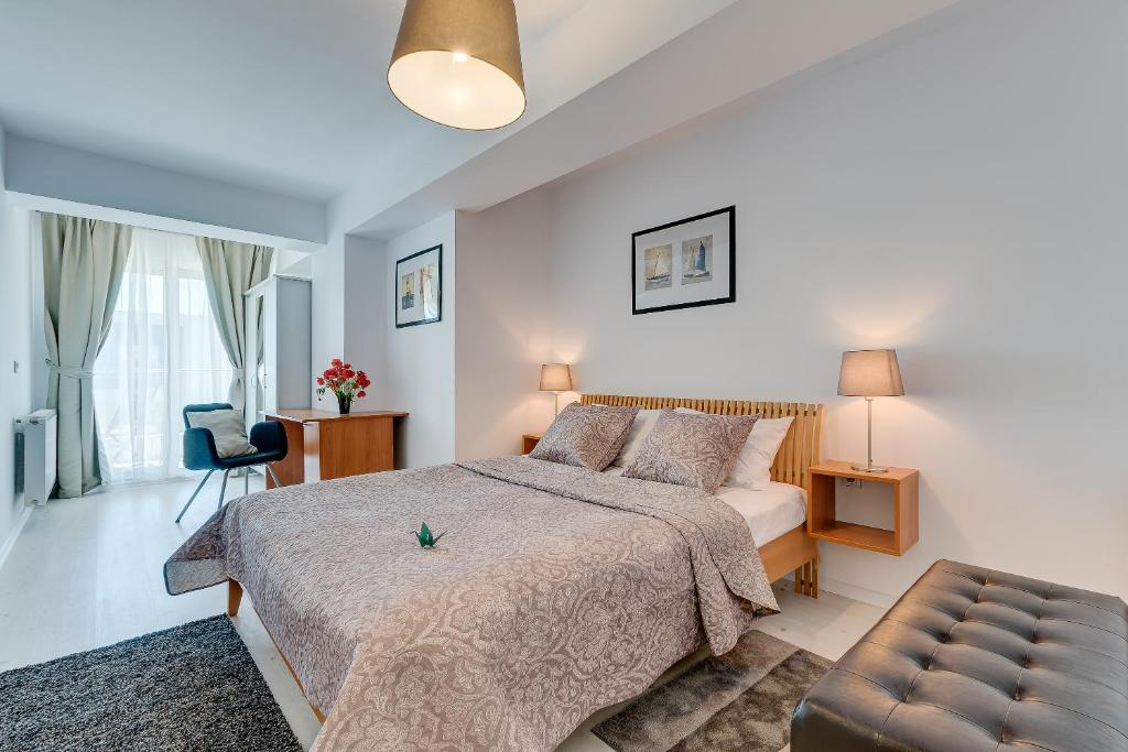 A bed or beds in a room at Bucharest Airport Apartments