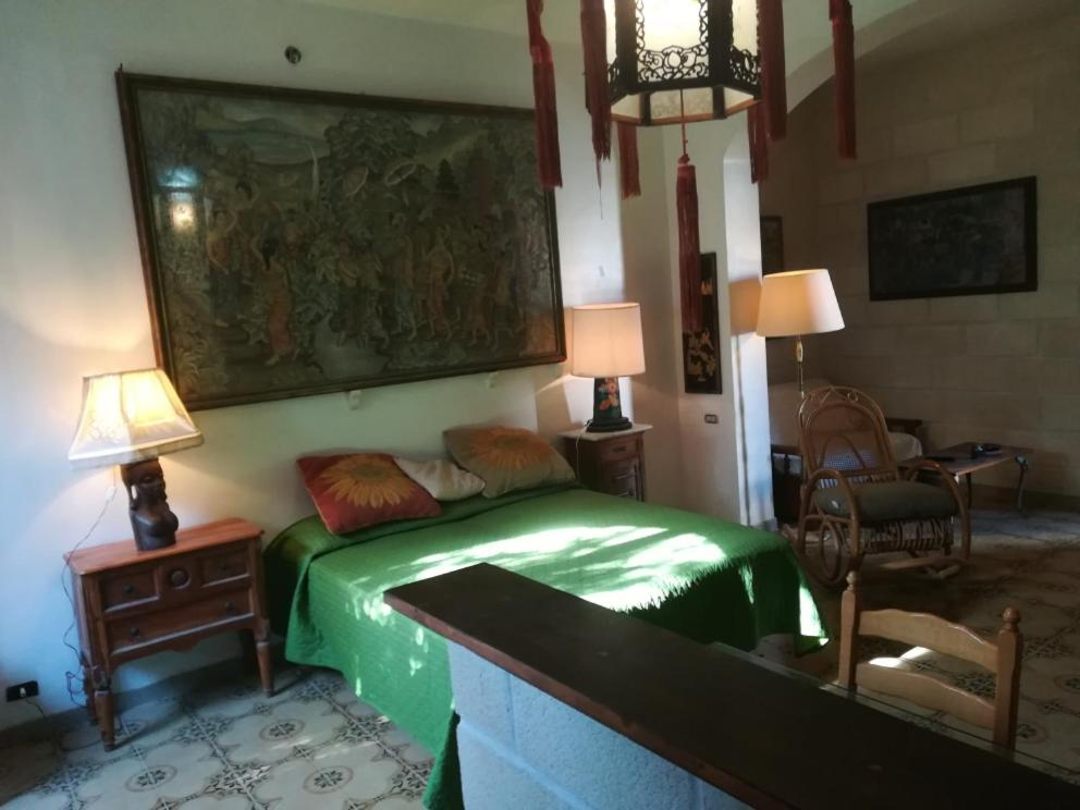 A bed or beds in a room at Casa Zagara
