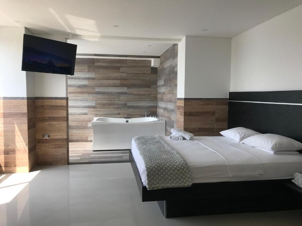Cama o camas de una habitación en Hotel La Esperanza