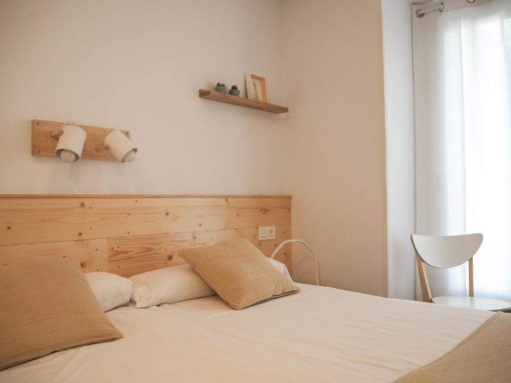 Ein Bett oder Betten in einem Zimmer der Unterkunft Pensión Urkia