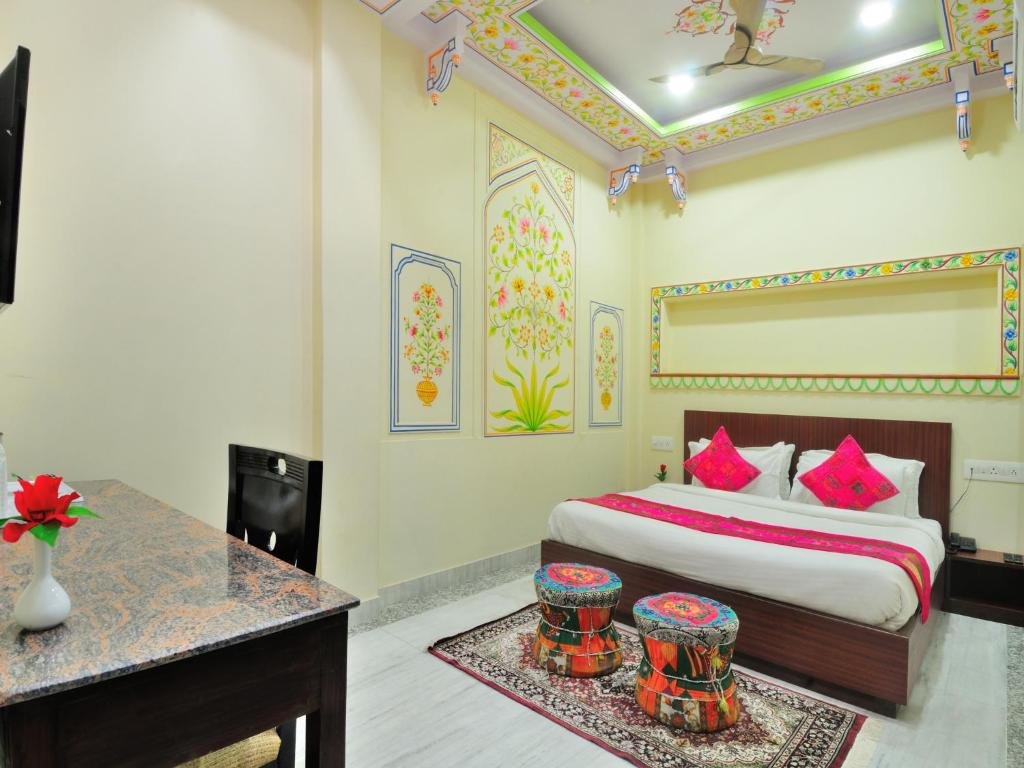A bed or beds in a room at Jorawar A Heritage Haveli