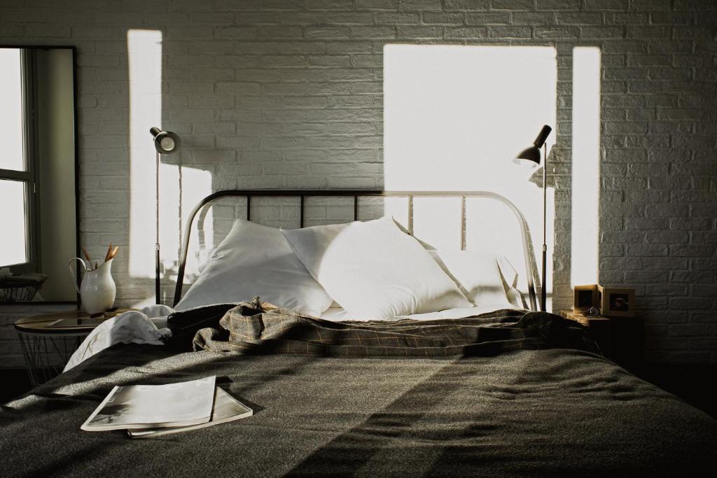 Un ou plusieurs lits dans un hébergement de l'établissement Room007 Ventura Hostel