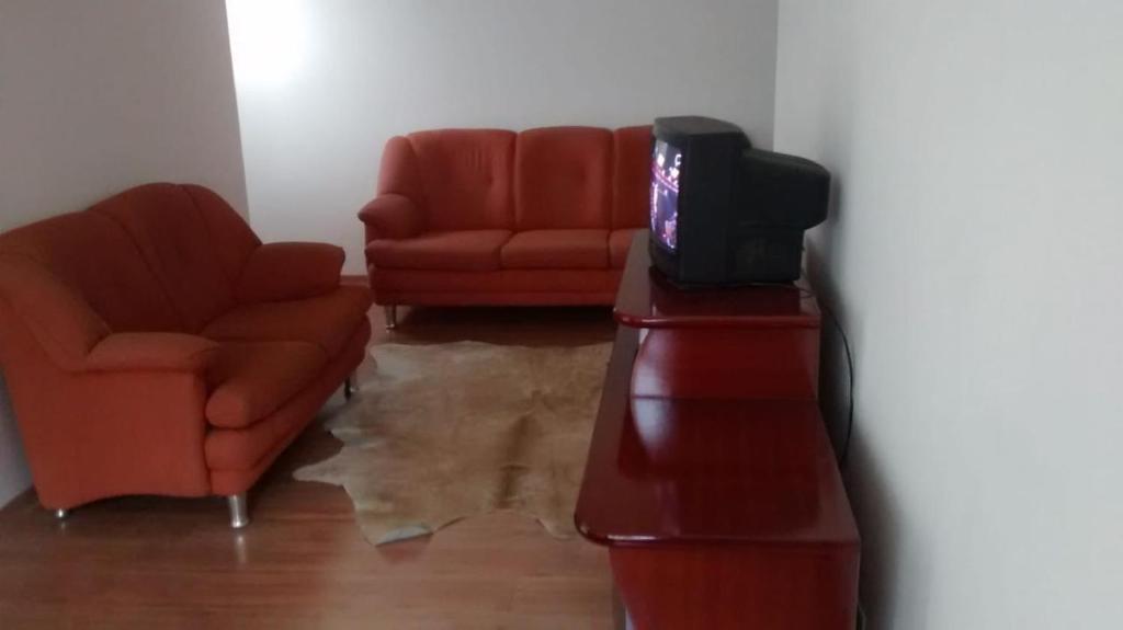 A seating area at Apt de Temporada Mobiliado (sem moradores)