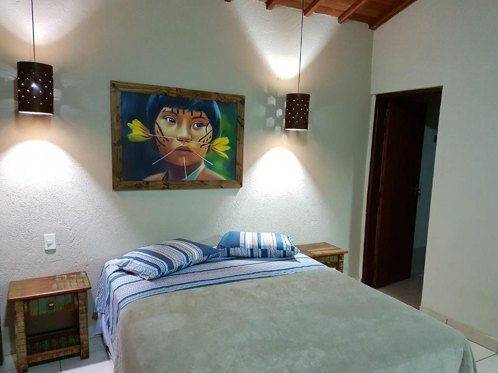 A bed or beds in a room at Chalé da Mantiqueira