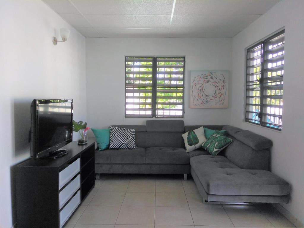 Atpūtas zona naktsmītnē Urban Terrace Apartment in San Juan