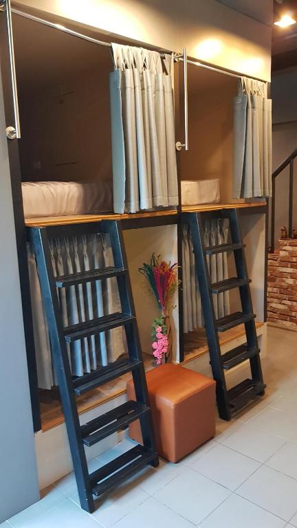 A bunk bed or bunk beds in a room at connect hostel patong