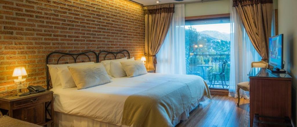 Una cama o camas en una habitación de Paraíso Casa de Montaña