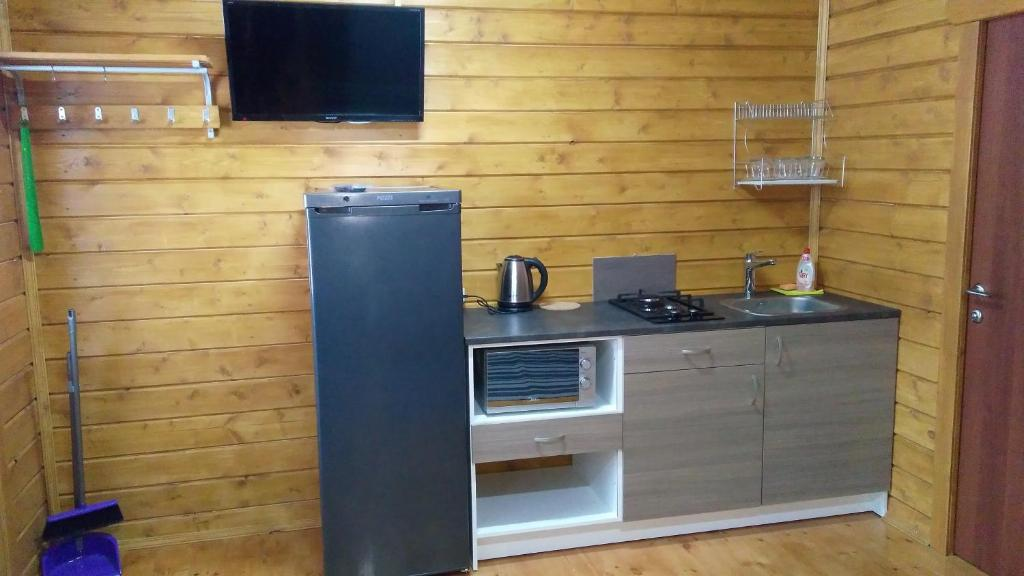 A kitchen or kitchenette at Guest House Belye Rosy