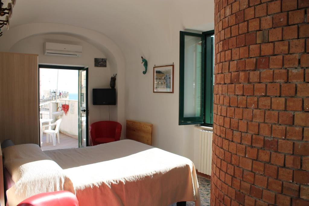 A bed or beds in a room at Attico del Cavaliere