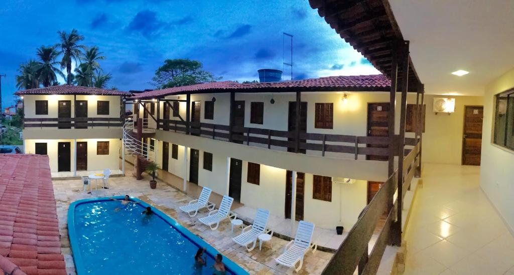 Uma vista da piscina em Novo Hotel Senhor dos Mares ou nos arredores