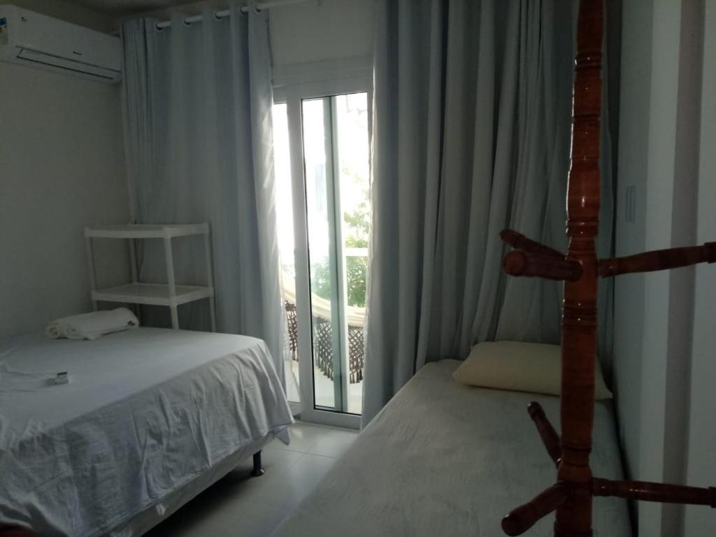 Een bed of bedden in een kamer bij Apartamentos Juliel