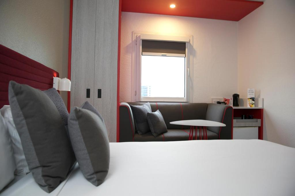 A bed or beds in a room at ibis Sydney Airport