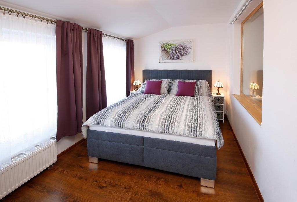 Postel nebo postele na pokoji v ubytování B&B Violet