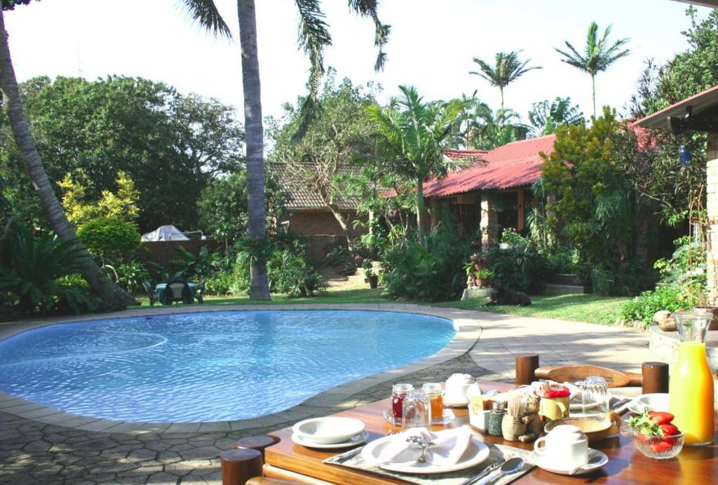 The swimming pool at or near Maputaland Guest House