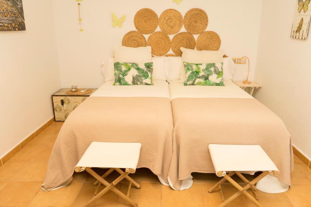 Cama o camas de una habitación en Casa Rural Las Eras en Monfragüe