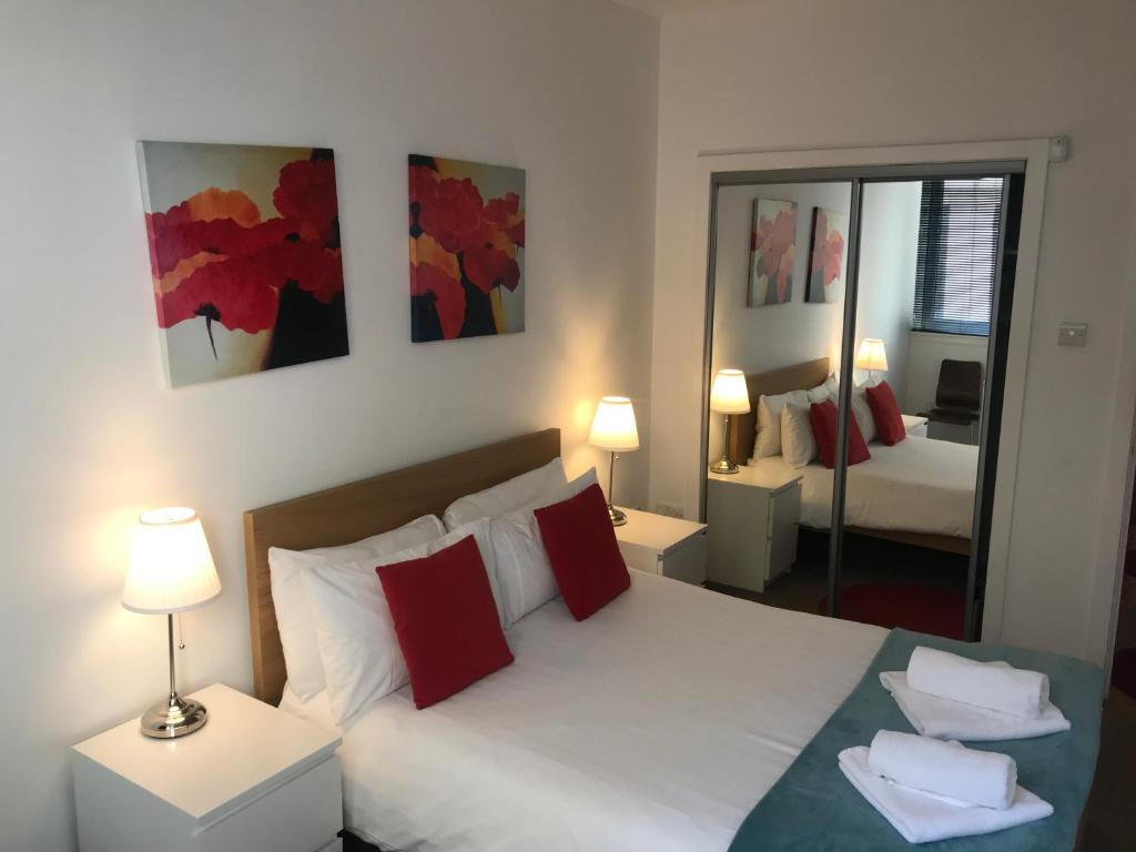 A bed or beds in a room at Variety Gate Apartment