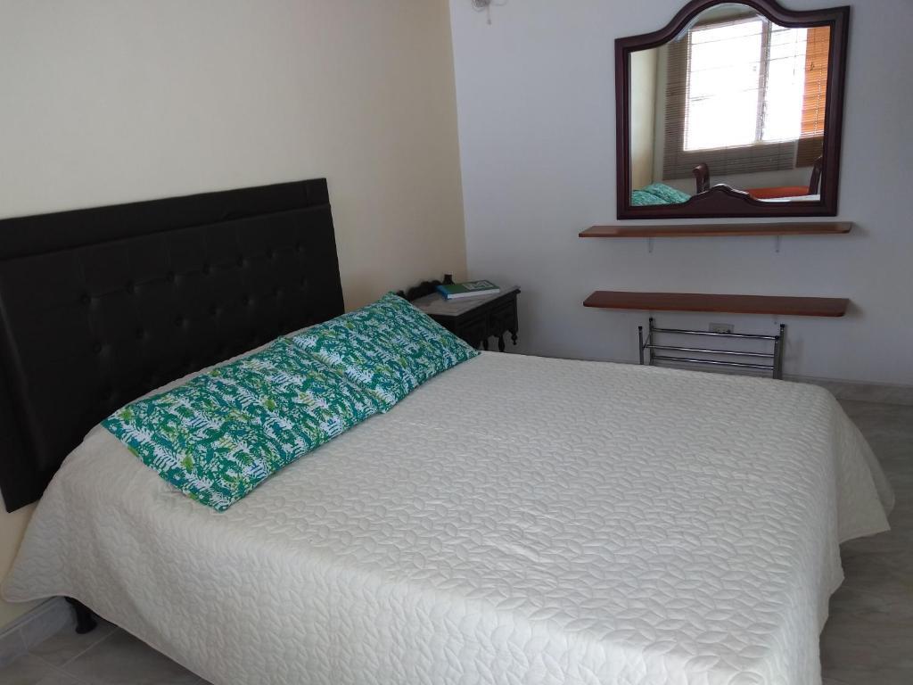 A bed or beds in a room at Bienvenidos todos