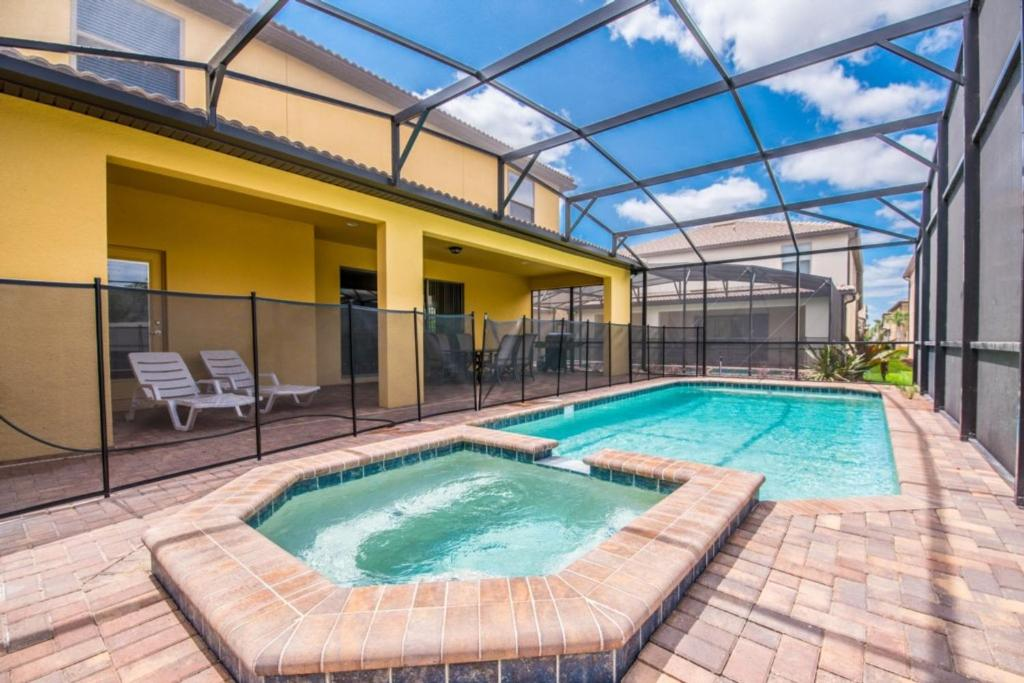 The swimming pool at or near Windsor at Westside Exec Villas- 2174TC
