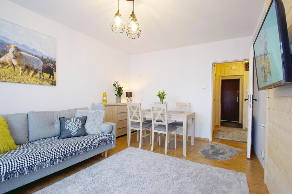 A seating area at Apartament Regionalny Centrum