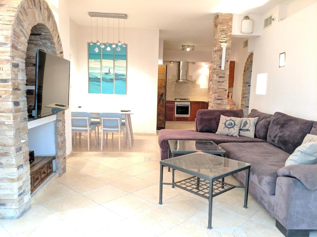 A seating area at Rustic style 2 BR Apt with Sea View
