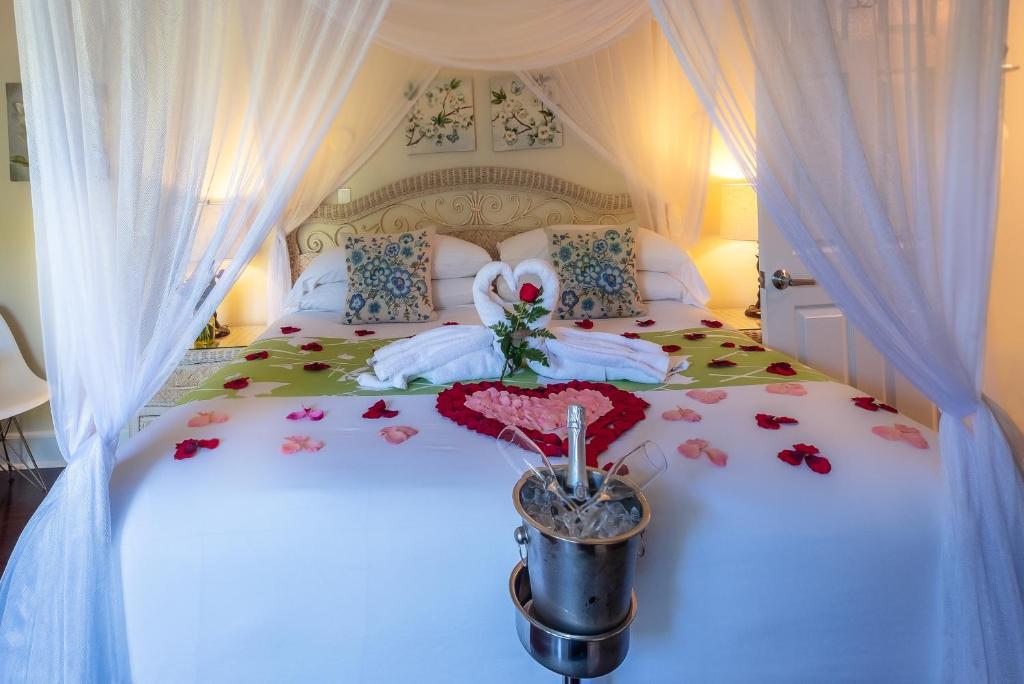 Cama o camas de una habitación en Duval Gardens